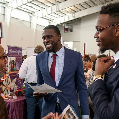 Temple's Michael Robinson talking to job seekers at the 2019 Annual Job Fair.