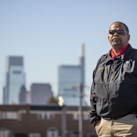 Image of a man in a Temple Police officer jacket outside in North Philadelphia.