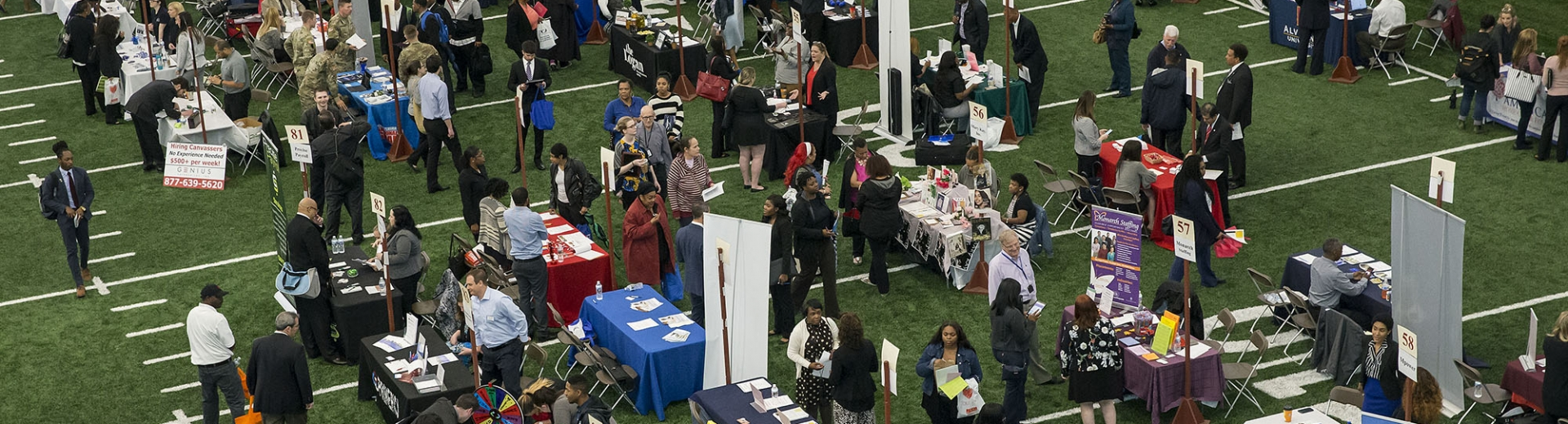 community members at a crowded job fair