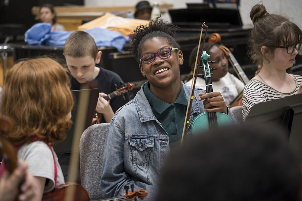 Young musician in a community ensemble
