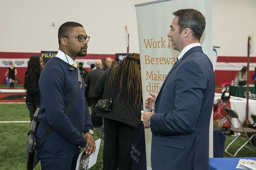 job seekers and employers interacting at a job fair